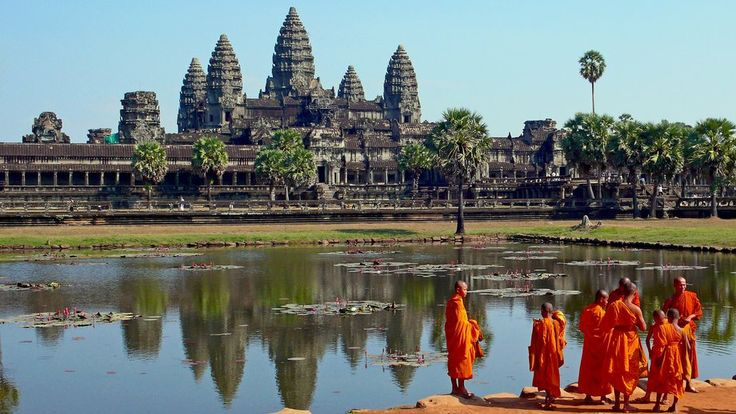 Buddhist monks in front of the reflecting pool at Angkor Wat, a UNESCO World Heritage Site.