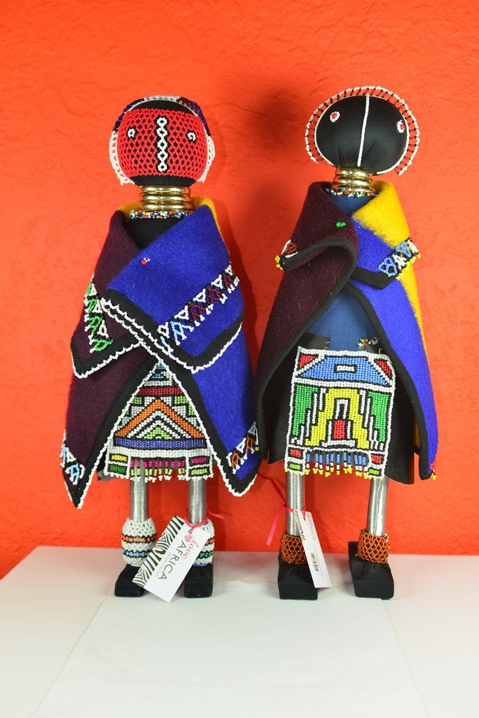 Hand made Ndebele dolls from South Africa - 23 inches tall Linga Koba dolls are from the Ndebele people in Southern Africa. The Ndebele are noted for their painted homes of brilliant colors that stand