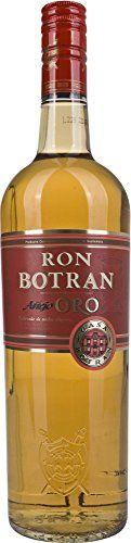 """ACHTUNG! Der Verschluss ist etwas undicht, daher ist eine geringe Fehlmenge möglich. Alle Flaschen sind aber original verschlossen! Botran Oro lagert mindestens 5 Jahre in Quetzaltenango auf 2330 m Höhe in Eichenholzfässern. Auch der Botran Anejo Oro 5 Anos wird bereits im Solera-System gereift. Auszeichnungen: Silbermedaille beim Cane Spirits Festival 2006 in Florida, in der Kategorie """"Dark Rums"""". Goldmedaillen Gewinner beim Internationalen Rum Fest in Kanada 2003. Goldmedaillengewinner…"""