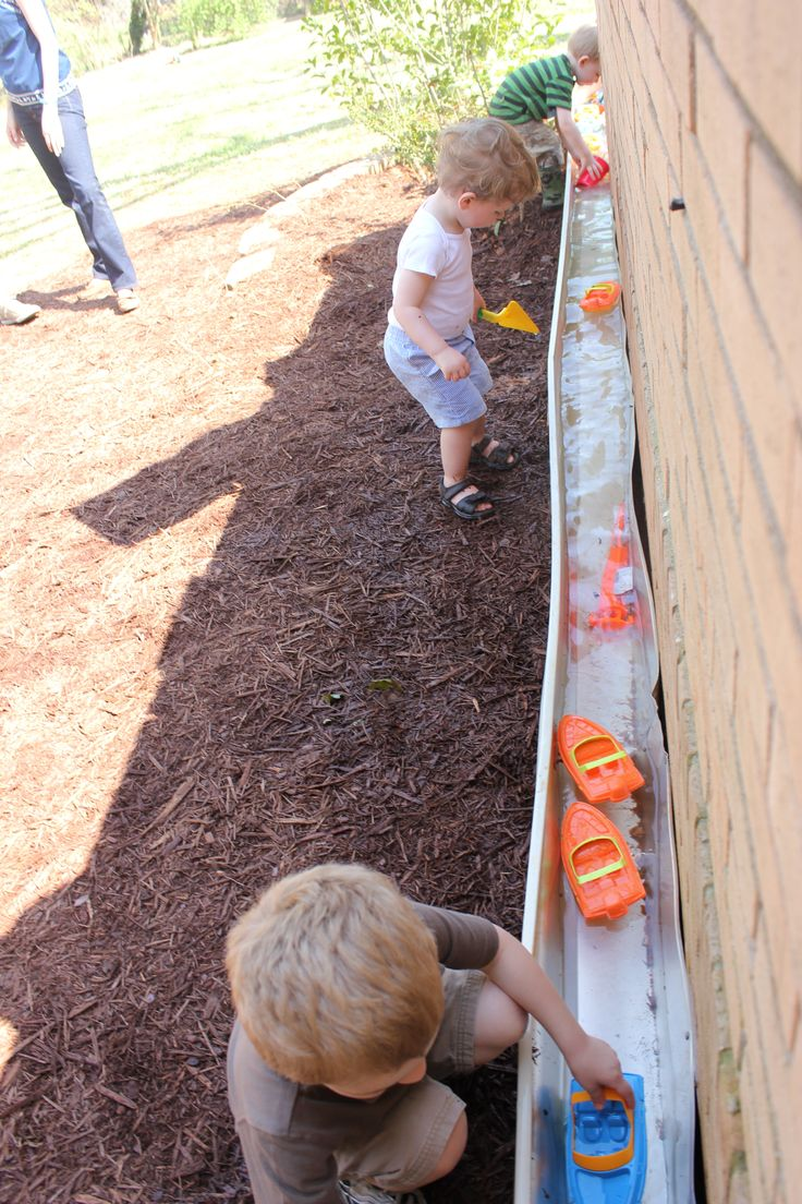 Pinner says: used an old rain gutter, with end caps on each side, and a small pump, to create a flowing waterway for plastic boats. kids loved it