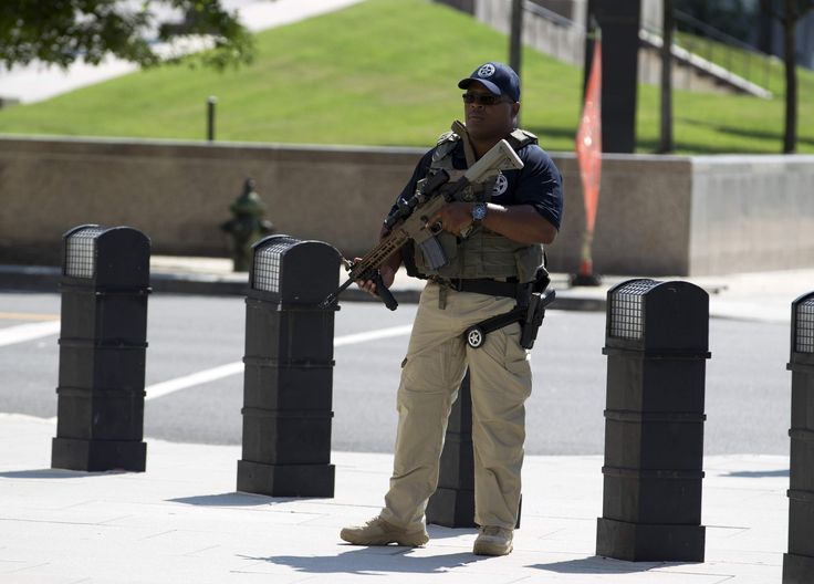 A U.S. Marshall stands guard outside of the federal U.S. District Court in Washington Saturday after security outside the court was heightened in anticipation of a possible court appearance by captured Libyan militant Ahmed Abu Khattala later in the day. Khatallah is one of the men accused in the deadly Benghazi attack at the U.S. embassy in Libya. THE ASSOCIATED PRESS