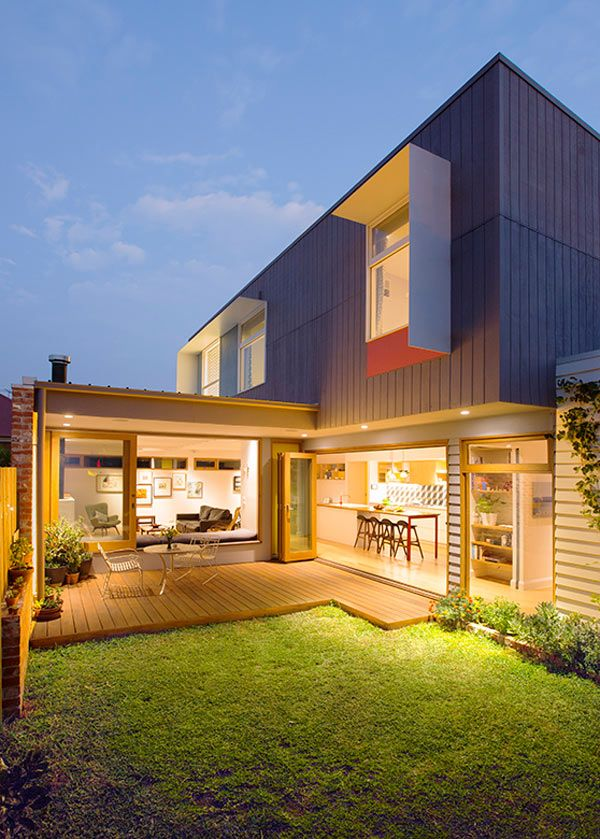 These designer homeowners purchased someone's backyard land and built an environmentally friendly, 2-story modern house built around a garden.