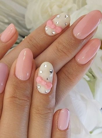 Pastel Pink and White Rounded Nails with Crystals and Bow.