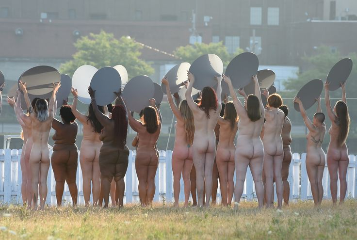 "Women participate in a photo shoot by artist Spencer Tunick in his latest large-scale art installation, ""Everything She Says Means Everything,"" in Cleveland. (Timothy A. Clary / AFP / Getty)"