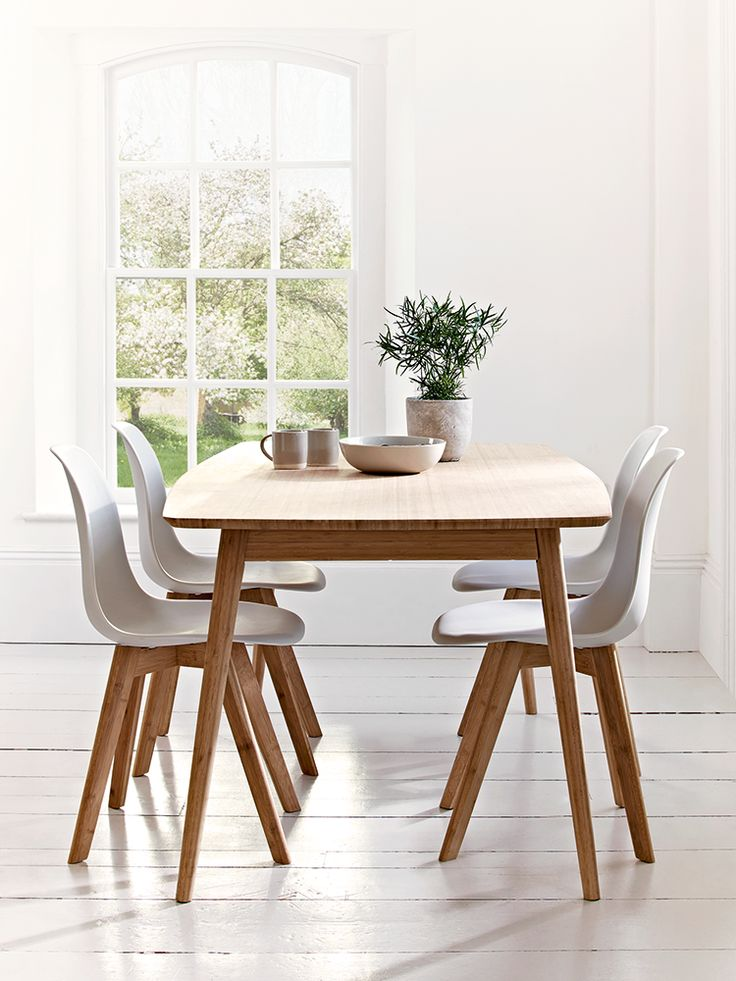 Aalto table with four dining chairs; sustainable design which is crafted from carbonised bamboo.