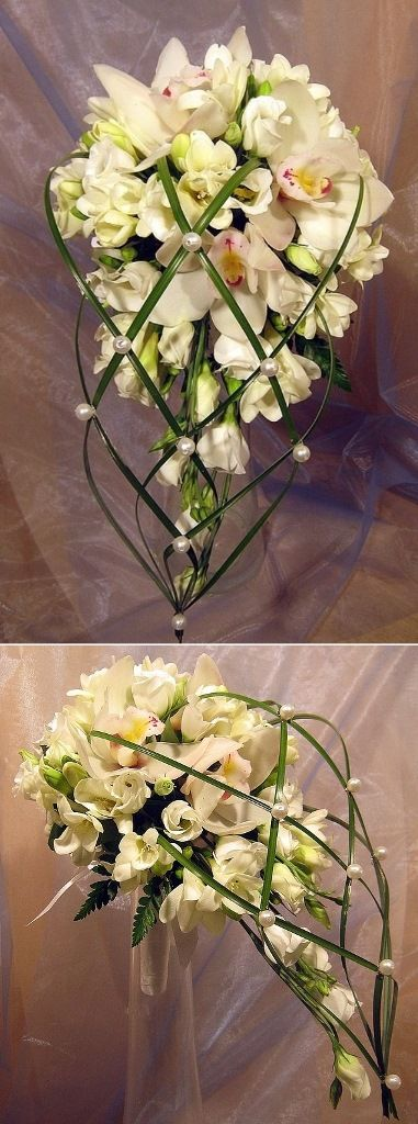 I would think that ribbon detail behind and below the bouquet would be a nice detail.  This one overpowers. Dd