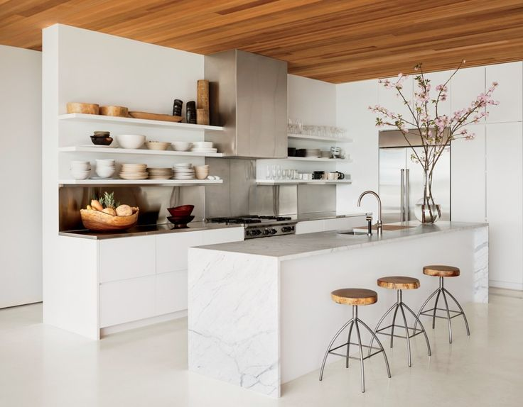 by 1100 Architect  Author and photographer Kelly Klein outfitted her Palm Beach, Florida, kitchen with a Sub-Zero refrigerator, a Wolf range, Dornbracht sink fittings, and a custom-made hood.