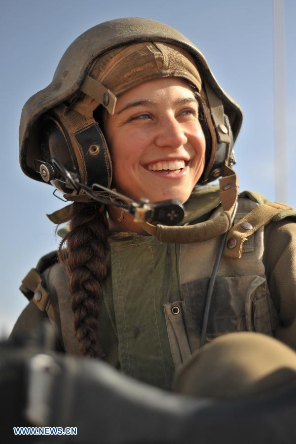 """Israel ~ IDF female soldier taking a break from her """"tank"""" duty . . ."""