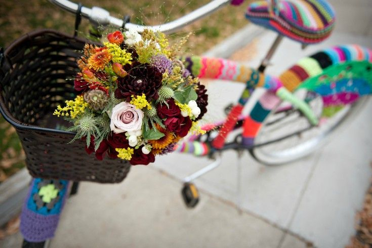 Fall bouquet of burgundy dahlias, solidago, Quicksand roses and eryngium thistle. So sweet with this yarn bombed cruiser from @stashlounge Photo by @tarawhitphoto  Read full post on yarn ideas for your wedding here. http://flowersbyjanie.com/blog/flowers-by-janie-calgary-wedding-florist/yarn-wedding-ideas-flowers-by-janie-calgary-wedding-florist #weddingyarnideas #yarnbombedbike #fallbridalbouquet #burgundydahlias #bouquetinbasket #Calgaryweddingflorist #Canmoreweddingflorist #FlowersbyJanie
