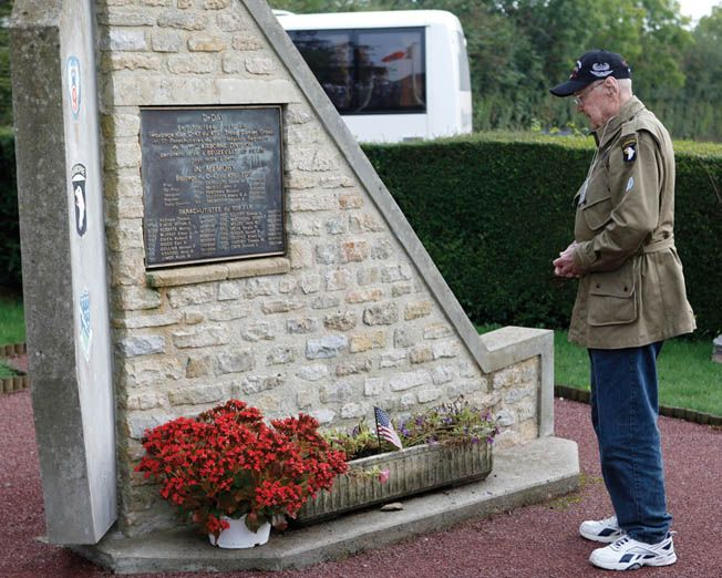 Ed Mauser, Band of brothers, pays tribute to his comrades who died in Lieutenant Thomas Meehan's airplane at the crash site memorial in Normandy in 2010. The memory of the plane going down stayed with Mauser the rest of his life.