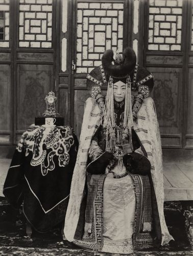 A Mongolian lady poses in an elaborate headdress. The inspiration for Queen Amidala? I think so.