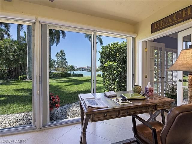 Coastal tropical desk on the lanai with a view of Doctors Bay.  Orleans Condos in the Moorings | Naples, Florida