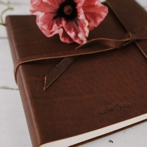 love you embossed leather photo album handmade book from claire magnolia