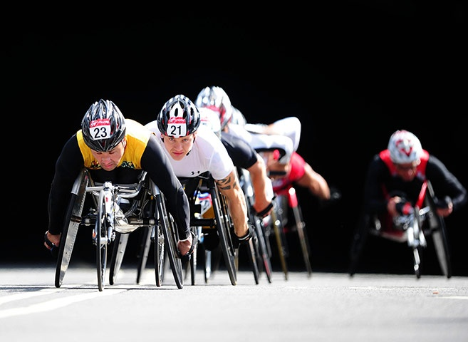 Great Britain's David Weir (wearing number 21) is well positioned in the men's wheelchair race...London Marathon 2012