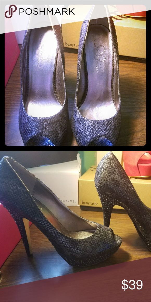 Platform heels, worn once Black phyton Mariah Carey stiletto. 2 inch platform by 5 inch heels height. Great condition. Lost the box it came in, but kept the shoes in great shape. Mariah Carey Shoes Heels