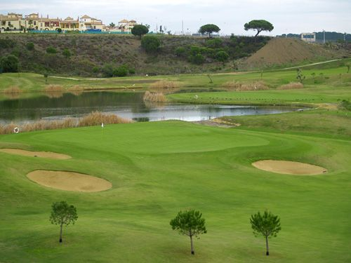 Club de Golf Costa Esuri - Campo Oeste. Both courses in this club have been designed to challenge golfer of all levels. From its links-style holes to holes between valleys and woodland, not forgetting the marshes, lakes and the river Guadiana that protects some greens and fairways.  From the magnificent greens, you will enjoy views of a privileged natural environment that will make your day´s golf an unforgettable experience…