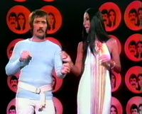 The Sonny & Cher Show!!  Frequently I was at my grandparents when this show came on.  So I always smell butane, cigarette smoke and the leather of my grandpa's chair when I see them together.