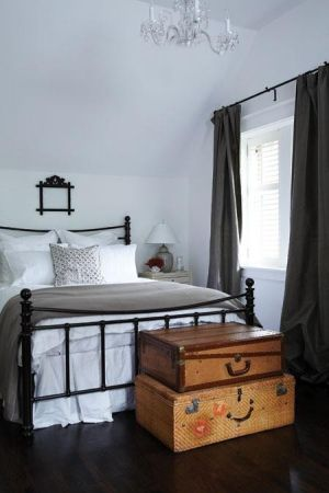 Wrought iron bed + white bedroom by ila , dark wood flooring