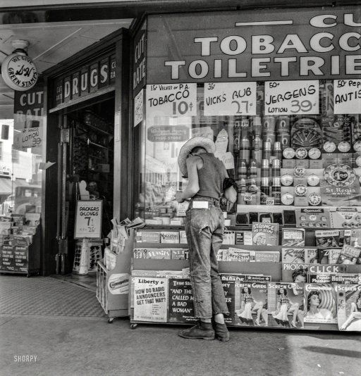 "August 1939. ""Medford, Oregon. Half-grown farm boy on main drugstore corner in town."" Not quite Lana Turner at Schwab's, even if the photographer is Dorothea Lange. Hey kid, your 15 minutes starts right ... now."