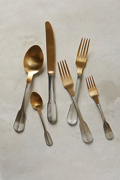 Gold-Tipped Flatware. This gives me an idea for paint dipped silverware. Only I'd dip the handle.