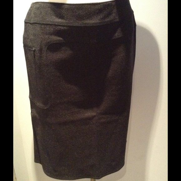MIU MIU PRADA Wool Skirt Beautiful charcoal grey skirt with piping detail. Sits at the hip. Side front zip pocket. Back zip. Lightweight wool fabric with some give (Lycra). Excellent condition. IT42. Miu Miu Skirts