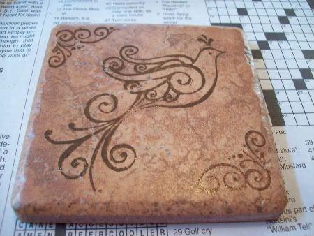 Simple stamped tile. I would want to spray a sealant on the tile after the stamping so it did not run once a sweaty drink were placed on it.