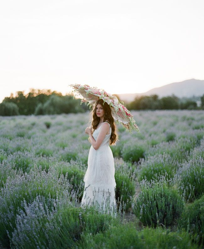 {Ruche Fall Bridal Collection + Win Dresses for Your Bridesmaids!}    The parasol overflowing with flowers (beautiful!) in a lavender field (I had no idea lavender grew in bushels! A nice alternative to a field.)