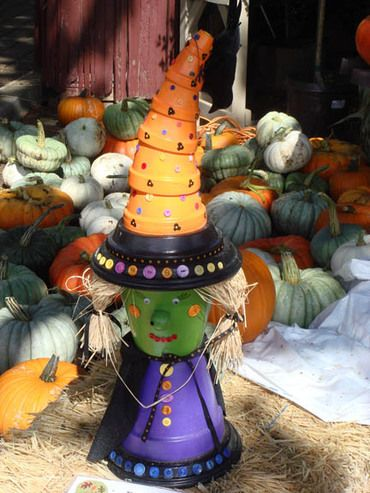 Super-cute flower pot witch.  No directions, but it looks simple enough to figure out how to make this.  Saw this on the Confessions of Crafty Witches page on Facebook.