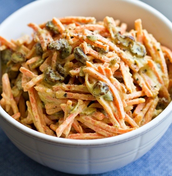 Carrot tahini slaw: 10 ounces julienne cut/matchstick carrots  1 cup organic Thompson Raisins  1/4 cup roasted pumpkin seeds  1/3 cup tahini  1-2 Tbsp Muchi Curry powder  1/4 cup lemon juice  2 Tbsp maple syrup  1/4 tsp fresh ground black pepper    Optional:  1/2 tsp garlic powder  dash of cayenne (for extra spicy salad)  dash of sea salt on top  1 Tbsp nutritional yeast (or sprinkled over top)