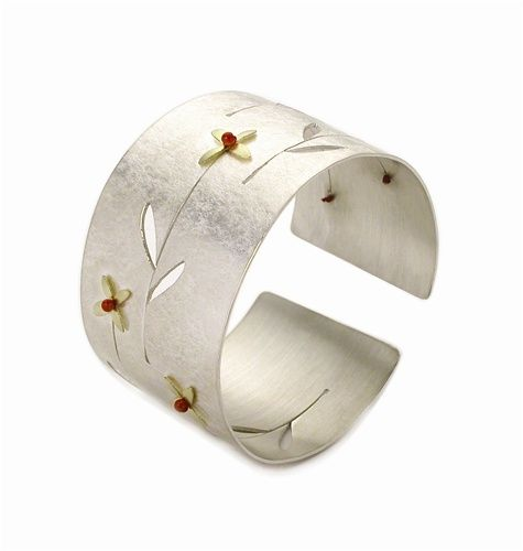 Cuff | Jamie Cassavoy.  Sterling silver with 18k gold and coral flowers.