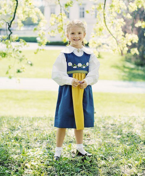 Princess Estelle, five, wore traditional national dress - a blue and yellow frock embroidered with daisies. The tradition of releasing a photo of Princess Estelle in the Swedish national dress began in 2013. Photo: Erika Gerdemark, The Royal Court, Sweden