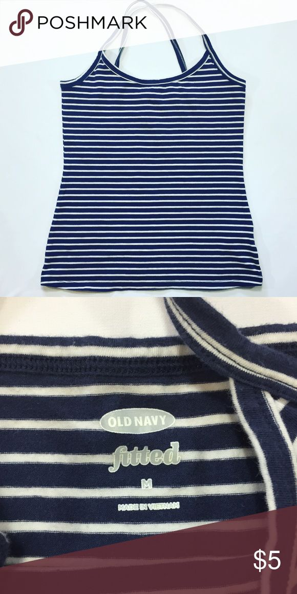 Old Navy Women's Top Stripped Fitted Tank Top Pre owned in great condition. Fitted 94% cotton 6% spandex. Navy blue and white stripes. Spaghetti straps they cross at the back. Old Navy Tops Tank Tops