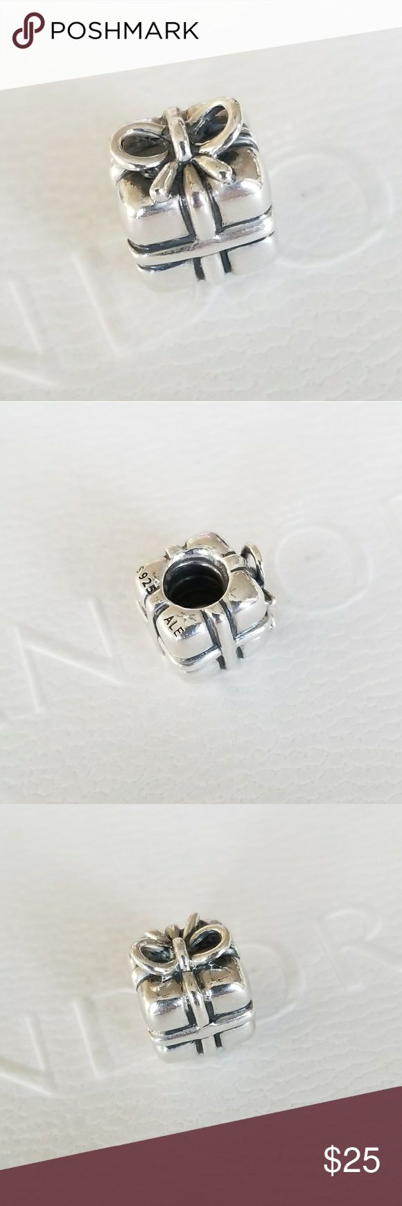Pandora Gift Box Present Silver Charm DISCONTINUED, Retired Present, Sterling Silver Item No. 790300  100% Authentic Pandora  Good used condition  Properly Stamped  Pandora stores offer lifetime free cleaning  No box included  Fast shipping Pandora Jewelry Bracelets #sterlingsilverjewelrycleaning