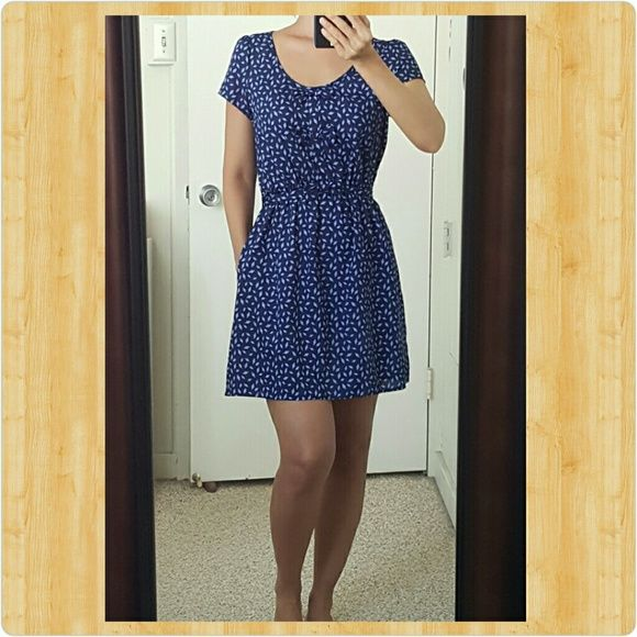"*Sale!* Cute, blue dress Cool material accentuated with 3 bows on the front.  Tie back waist, elastic waistband, and pockets! I am 5'4"" for reference. Forever 21 Dresses"