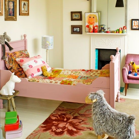 Give your child's bedroom a feeling of individuality with vintage-inspired pieces such as a patchwork quilt and rustic frames. All white walls and floors mean the room can grow as the child does.