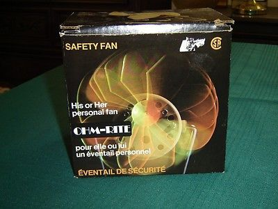 "#Vintage #Ohm_Rite personal #safety_fan NIB (6A_B)   Safe, portable, quiet, powerful, compact   COOLS LIKE A BIG FAN   Works in almost any direction - approximately 270° rotation   Rubber fan blades for safety   Cord length is 68"" (172.7 cm) with in-line on/off switch   This fan measures 2 9/16"" (6.5 cm) high x 3 7/16"" (8.7 cm) wide x 5 9/16"" (14.1 cm) deep   Specifications:  •115V •60 Hz •.35 Amp •CSA Approved   Made in Canada    This unit is tested and working   03082012BILL6A_B"