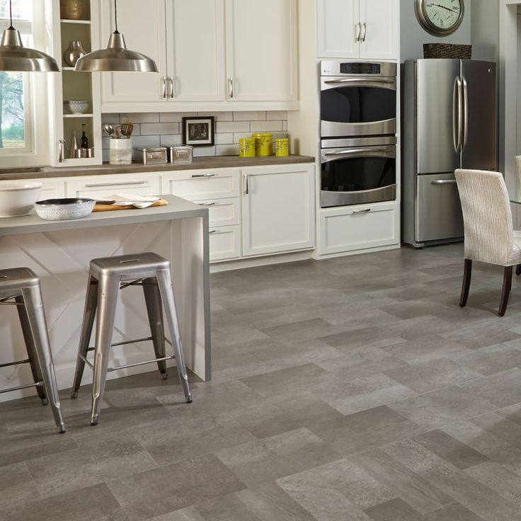 Adura® Meridian is a weathered concrete look with a mix of light and dark shadows.