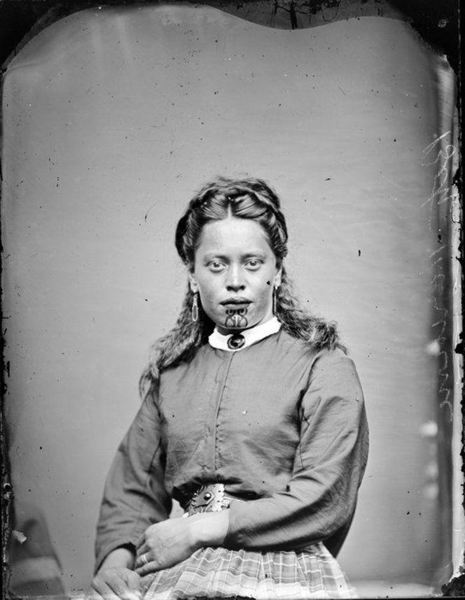 Unidentified young Maori woman with clear chin moko, 1870-1889