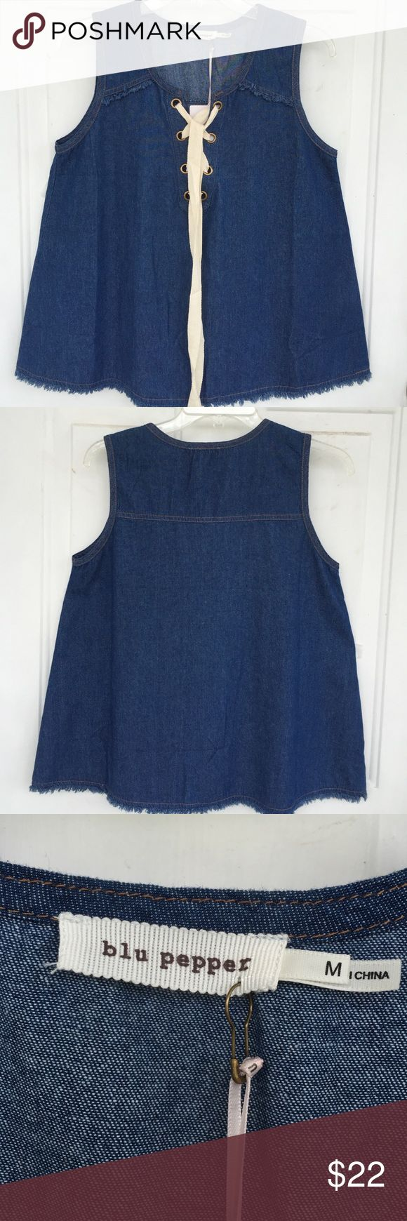 """💙blu pepper top💙 Wonderful, versatile denim top from blu pepper. Features grommet front with lace up tie and fringe detail on shoulders and hem. Size medium, measuring 18"""" pit-pit and 24"""" long. Purchased from Buckle. Never worn. Blu Pepper Tops Tunics"""