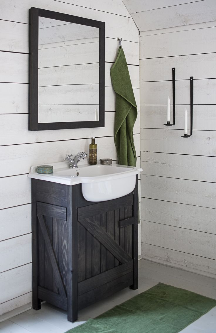 Create contrast and style with white paneling and a vintage-inspired, rustic, wooden sink.
