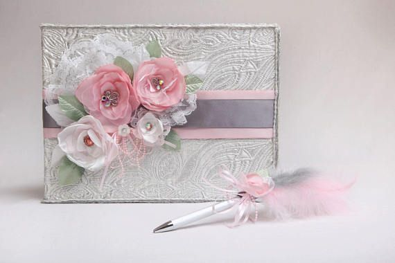 Livre d'or mariage argent fleurs roses blanches stylo