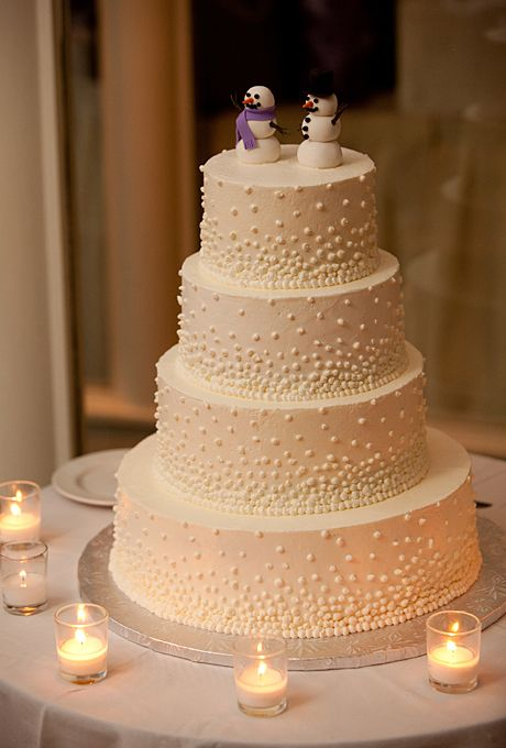 Brides.com: 34 Stunning Wedding Cakes for a Winter Wedding. A Dotted Wedding Cake with a Snowmen Topper. This A White Cake design could be one of the cutest winter wedding cakes we've ever seen. The four-tier buttercream confection gets all of its whimsy from the dots and adorable snowmen topper. It's unmistakably winter and sure to please guests of all ages. See more whimsical wedding cakes.