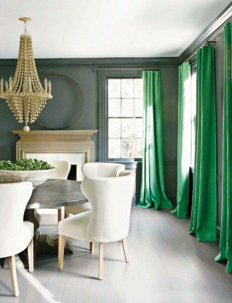LOVE the shot of emerald green in the curtains with the cool gray scheme - Comfortable home