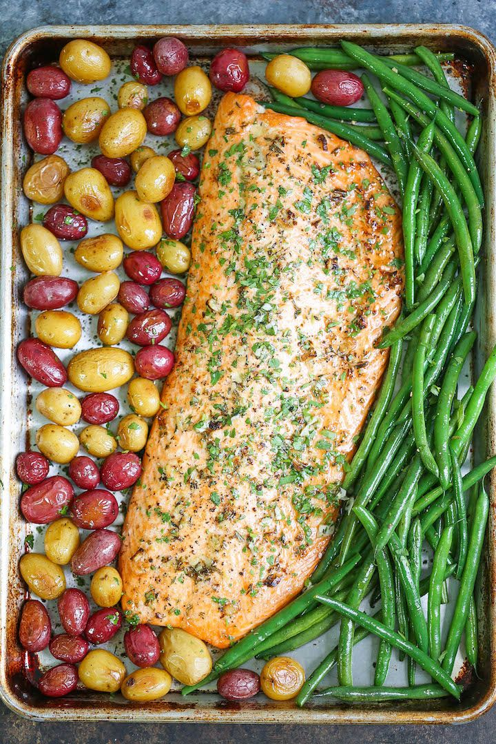 Sheet Pan Garlic Butter Salmon with roasted potatoes and green beans with garlic butter sauce!
