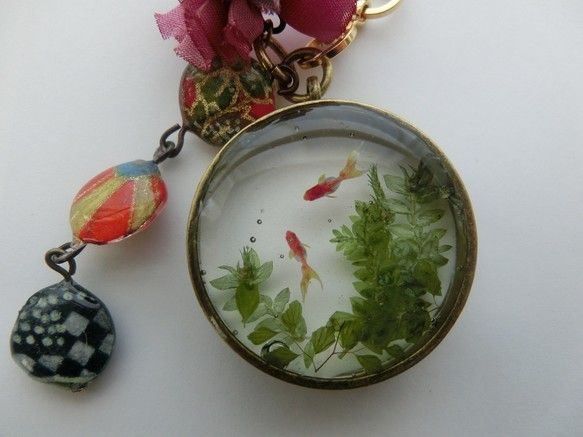 miniature fish pond artwork encased in resin with open back pipe ring pendant