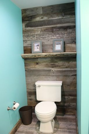 Rustic Powder Room with Umbra Metalla 3-Gal. Trash Can, High ceiling, Powder room, Hardwood floors