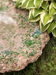 Homemade bird bath using concrete and recycled glass