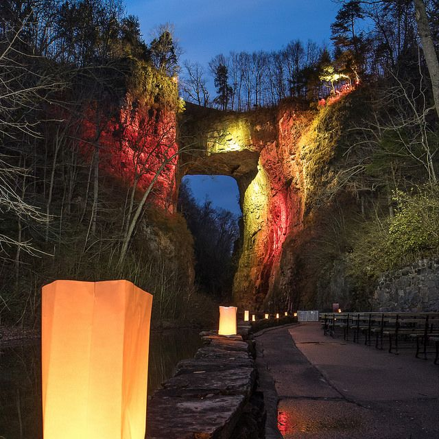 Luminary Nights See The Bridge After Dark Lit Up In Festive Holiday Color Natural Bridge Sta Natural Bridge Virginia Natural Bridge Great Places To Travel