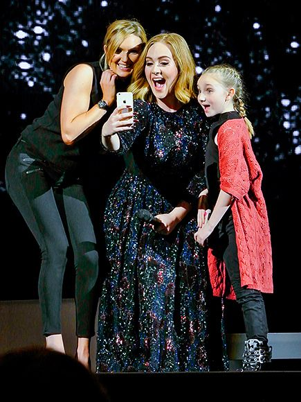 Star Tracks: Thursday, March 31, 2016 | LOVE YOUR SELFIE | Dreams do come true! Adele snaps a pic with two lucky fans during her concert in Birmingham, UK, on Thursday.