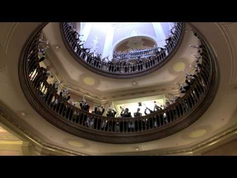"In one of the most spectacular displays of school tradition, the trumpets of the Band of the Fighting Irish gather under the Golden Dome (the Main Building) one hour before kick-off on home game days and play ""Notre Dame Our Mother,"" and ""The Notre Dame Victory March"" to a standing-room only crowd. Filmed in the Fall of 2009, over the course of four performances."